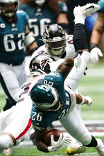 Philadelphia Eagles running back Miles Sanders (26) is hit by Atlanta Falcons cornerback A.J. Terrell (24) during the first half of an NFL football game, Sunday, Sept. 12, 2021, in Atlanta. (AP Photo/John Bazemore)