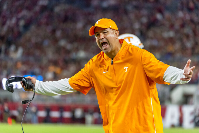 "FILE - In this Oct. 19, 2019, file photo, Tennessee head coach Jeremy Pruitt yells at the officials during an NCAA college football game against Alabama in Tuscaloosa, Ala. The SEC came into this season with a contingency plan to deal with coronavirus-related issues. ""Obviously, we can't predict the future,"" Tennessee coach Jeremy Pruitt said. ""I believe we all knew when we started this, that there were no guarantees."" (AP Photo/Vasha Hunt, File)"