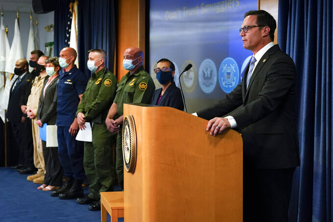 Acting United States Attorney Randy Grossman, right, speaks alongside area federal law enforcement officials Wednesday, June 2, 2021, in San Diego. The officials called for migrants contemplating crossing the border illegally to be aware of the dangers, after a wave of smuggling deaths in the region. (AP Photo/Gregory Bull)