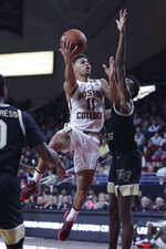 Boston College guard Derryck Thornton (11) drives to the basket against Wake Forest during the second half of an NCAA college basketball game in Boston, Wednesday, Nov. 6, 2019. Thornton scored 23 in Boston College's 77-70 win. (AP Photo/Charles Krupa)