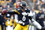 Pittsburgh Steelers quarterback Devlin Hodges (6) is sacked buy Cleveland Browns defensive end Chad Thomas (92) in the first half of an NFL football game, Sunday, Dec. 1, 2019, in Pittsburgh. (AP Photo/Don Wright)