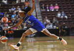 Connecticut Sun's Jasmine Thomas scrambles for a ball heading out of bound during the team's WNBA basketball game against the Minnesota Lynx on Tuesday, Aug. 17, 2021, in Uncasville, Conn. (Sarah Gordon/The Day via AP)