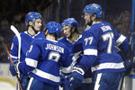 Tampa Bay Lightning center Anthony Cirelli. second from right, celebrates with teammates, including defenseman Victor Hedman (77) and center Tyler Johnson (9), after his goal against the Pittsburgh Penguins during the second period of an NHL hockey game Thursday, Feb. 6, 2020, in Tampa, Fla. (AP Photo/Chris O'Meara)
