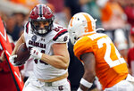 South Carolina tight end Kyle Markway (84) runs for yardage as he's defended by Tennessee defensive back Jaylen McCollough (22) in the first half of an NCAA college football game Saturday, Oct. 26, 2019, in Knoxville, Tenn. (AP Photo/Wade Payne)