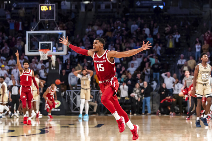 Arkansas guard Mason Jones (15) reacts after hitting the game-winning 3-pointer in overtime of an NCAA college basketball game against Georgia Tech Monday, Nov. 25, 2019, in Atlanta. Arkansas won 62-61. (AP Photo/Danny Karnik)
