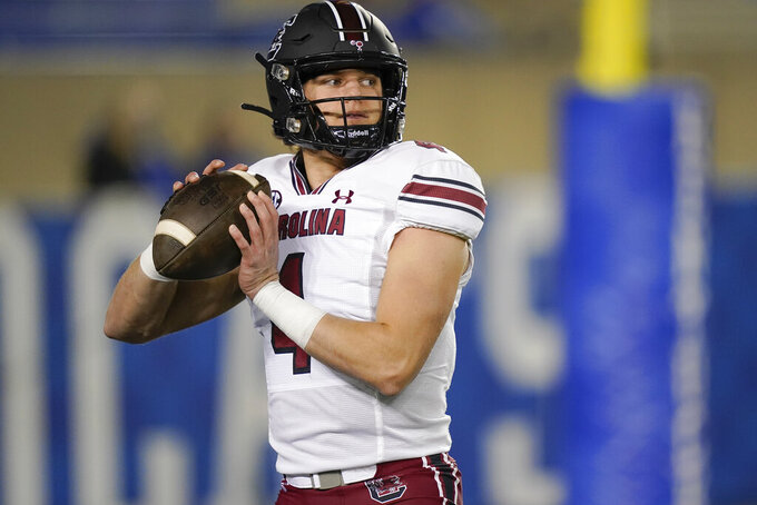 South Carolina quarterback Luke Doty (4) warms up before an NCAA college football game against Kentucky, Saturday, Dec. 5, 2020, in Lexington, Ky. (AP Photo/Bryan Woolston)