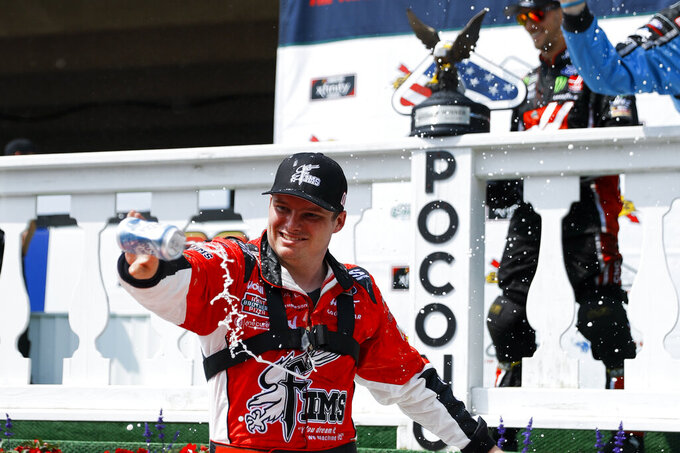 Cole Custer celebrates after winning the NASCAR Xfinity Series auto race at Pocono Raceway, Saturday, June 1, 2019, in Long Pond, Pa. (AP Photo/Matt Slocum)
