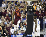 Virginia Tech guard Ahmed Hill (13) celebrates after scoring, next to Duke forward Zion Williamson (1) during the first half of an NCAA men's college basketball tournament East Region semifinal in Washington, Friday, March 29, 2019. (AP Photo/Patrick Semansky)