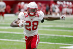 In this photo taken Aug. 7, 2019, Nebraska running back Maurice Washington (28) runs a drill during NCAA college football preseason practice in Lincoln, Neb. It is still unknown if Washington is allowed to play. Washington faces charges in California for texting a pornographic video to a former girlfriend. (AP Photo/Nati Harnik)
