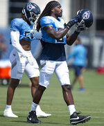 Tennessee Titans outside linebacker Jadeveon Clowney (99) puts on his helmet during an NFL football practice in Nashville, Wednesday, Sept. 9, 2020. (George Walker IV/The Tennessean via AP, Pool)