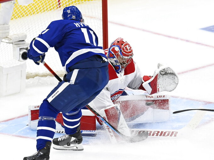 Montreal Canadiens goaltender Carey Price (31) stops Toronto Maple Leafs left wing Zach Hyman (11) on a breakaway during the third period in Game 5 of an NHL hockey Stanley Cup first-round playoff series in Toronto on Thursday, May 27, 2021. (Frank Gunn/The Canadian Press via AP)