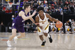 Minnesota's Marcus Carr (5) goes to the basket against Northwestern's Ryan Greer (2) during the first half of an NCAA college basketball game at the Big Ten Conference tournament, Wednesday, March 11, 2020, in Indianapolis. (AP Photo/Darron Cummings)