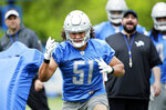 Detroit Lions linebacker Jahlani Tavai (51) comes off a blocking sled as head coach Matt P{Patricia, right, looks on during NFL football training camp Wednesday, June 5, 2019, in Allen Park, Mich. (AP Photo/Duane Burleson)