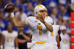 Kent State quarterback Dustin Crum (7) passes downfield against Texas A&M during the first half of an NCAA college football game on Saturday, Sept. 4, 2021, in College Station, Texas. (AP Photo/Sam Craft)