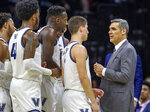 Villanova head coach Jay Wright talks to his players during a break in the action in the first half of an NCAA college basketball game against Providence, Saturday, Feb. 29, 2020, in Philadelphia, Pa. (AP Photo/Laurence Kesterson)
