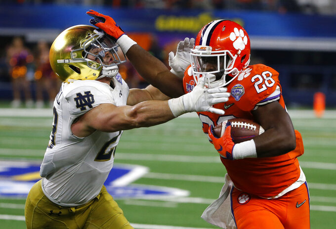 Notre Dame linebacker Drue Tranquill (23) attempts to stop Clemson running back Tavien Feaster (28) from gaining extra yardage on a running play in the second half of the NCAA Cotton Bowl semi-final playoff football game, Saturday, Dec. 29, 2018, in Arlington, Texas. (AP Photo/Michael Ainsworth)