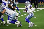 Dallas Cowboys running back Ezekiel Elliott (21) runs the ball in the second half of an NFL football game against the Philadelphia Eagles in Arlington, Texas, Sunday, Dec. 27. 2020. (AP Photo/Michael Ainsworth)