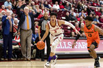 Stanford guard Tyrell Terry (3) dribbles as Oregon State guard Antoine Vernon (13) defends and Oregon State coach Wayne Tinkle gestures in the background during the first half of an NCAA college basketball game Thursday, Jan. 30, 2020, in Stanford, Calif. (AP Photo/John Hefti)