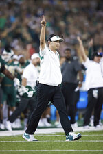 Charlotte head coach Will Healy reacts after a play during an NCAA college football game against Duke, Friday, Sept. 3, 2021, in Charlotte, N.C. (AP Photo/Brian Westerholt)