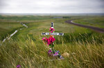 FILE - In this July 14, 2018, file photo, a makeshift memorial stands near the scene where Charlene Mancha was murdered by her husband last year on the Blackfeet Indian Reservation in Browning, Mont. Friday, April 26, 2019 marks the beginning of a two-day powwow in New Mexico that represents one of the largest annual gatherings of indigenous people in the United States. Organizers say they want to build awareness this year around the deaths and disappearances of Native American women. (AP Photo/David Goldman, File)
