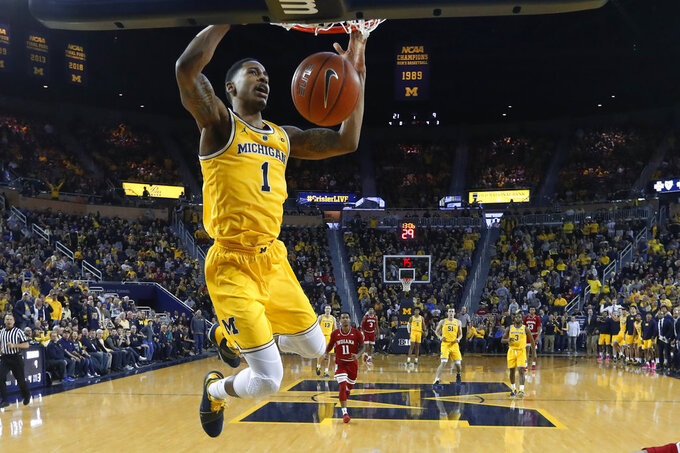 Michigan guard Charles Matthews dunks in the first half of an NCAA college basketball game against Indiana in Ann Arbor, Mich., Sunday, Jan. 6, 2019. (AP Photo/Paul Sancya)