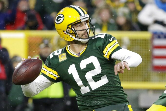 Green Bay Packers' Aaron Rodgers throws during the first half of an NFL football game against the Carolina Panthers Sunday, Nov. 10, 2019, in Green Bay, Wis. (AP Photo/Mike Roemer)