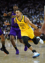 Golden State Warriors guard Stephen Curry (30) drives to the basket against Los Angeles Lakers guard Kentavious Caldwell-Pope (1) during the second half of an NBA basketball game Tuesday, Dec. 25, 2018, in Oakland, Calif. The Lakers won 127-101. (AP Photo/Tony Avelar)