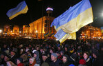People rally to commemorate victims of clashes with security forces six years ago at the Independence Square in Kyiv, Ukraine, Thursday, Nov. 21, 2019. People mark the sixth anniversary of the beginning of the protest movement and the subsequent events in late Feb. 2014 which led to the departure of former Ukraine's President Victor Yanukovych and the formation of the new government. (AP Photo/Efrem Lukatsky)
