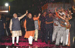 Indian Prime Minister Narendra Modi and Bharatiya Janata Party (BJP) President Amit Shah greet supporters on arrival at the party headquarters in New Delhi, India, Thursday, May 23, 2019. Modi's Hindu nationalist party claimed it won reelection with a commanding lead in Thursday's vote count, while the head of the main opposition party conceded a personal defeat that signaled the end of an era for modern India's main political dynasty. (AP Photo)