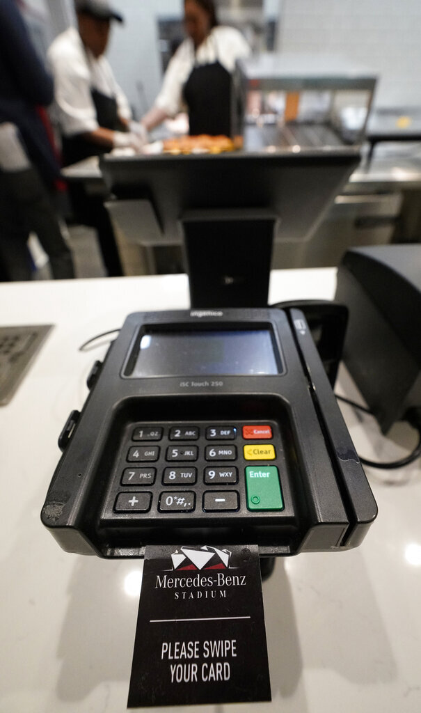 A credit card machine is shown at Mercedes-Benz Stadium during a tour for the NFL Super Bowl 53 football game Tuesday, Jan. 29, 2019, in Atlanta. During its sponsorship renewal with the NFL through the 2025 season, Visa envisions the first cashless Super Bowl. (AP Photo/David J. Phillip)