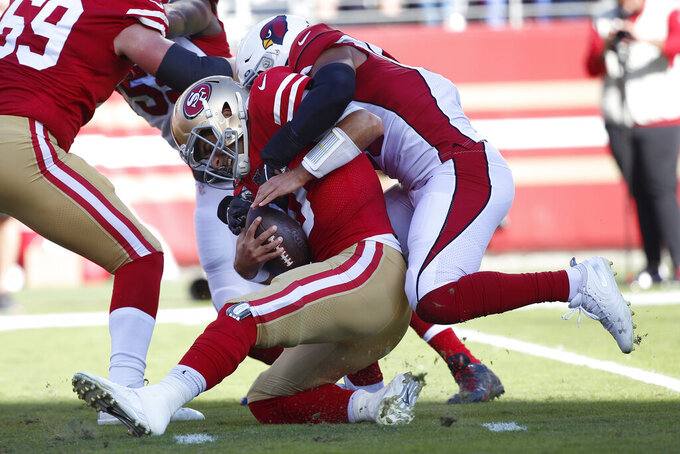 Arizona Cardinals middle linebacker Jordan Hicks, right, sacks San Francisco 49ers quarterback Jimmy Garoppolo during the first half of an NFL football game in Santa Clara, Calif., Sunday, Nov. 17, 2019. (AP Photo/Josie Lepe)