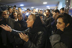 A friend of sailors who died aboard a tanker that sank off the coast of China speaks as families, friends and colleagues gather at the headquarters of the National Iranian Tanker Company, in Tehran, Iran, Sunday, Jan. 14, 2018. The burning Iranian tanker listing for days off the coast of China after a collision with another vessel sank Sunday, with an Iranian official saying there was