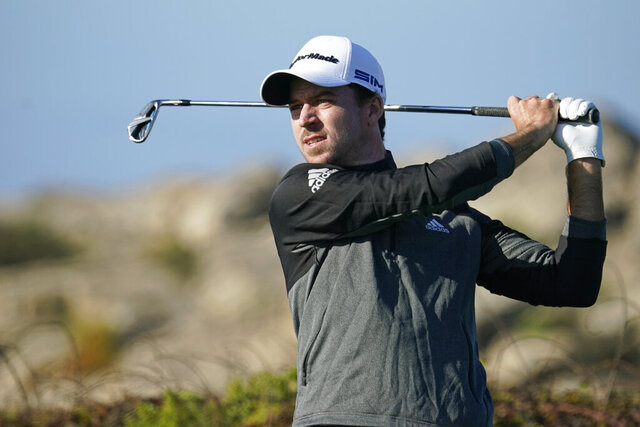 Nick Taylor follows his shot from the ninth tee of the Monterey Peninsula County Club Shore Course during the first round of the AT&T Pebble Beach National Pro-Am golf tournament Thursday, Feb. 6, 2020, in Pebble Beach, Calif. (AP Photo/Tony Avelar)