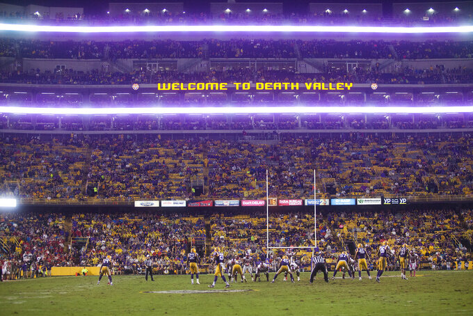 FILE - In this Oct. 24, 2015, file photo, Western Kentucky lines up on offense against LSU during an NCAA college football game at Tiger Stadium in Baton Rouge, La. LSU and Caesar's Sportsbook announced Friday, Sept. 17, 2021, that they have entered into a multi-year sponsorship agreement, making Louisiana's flagship state university the first in the Southeastern Conference to enter a financial partnership with a gambling company.  (Austin Anthony/Daily News via AP, File)