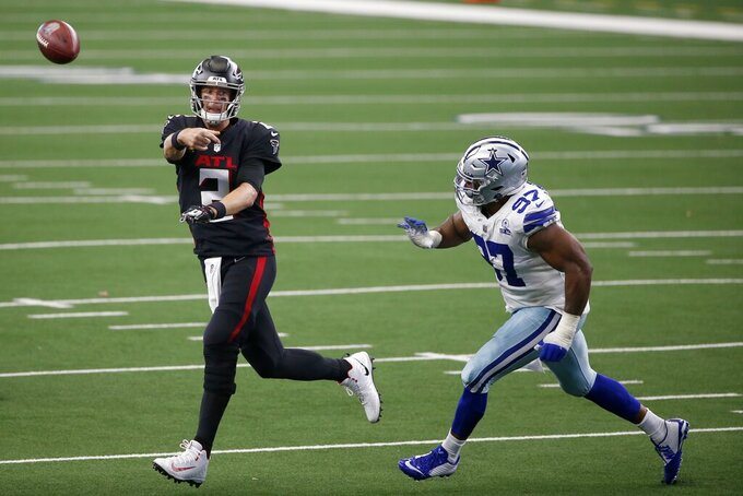 Atlanta Falcons quarterback Matt Ryan (2) throws a pass as Dallas Cowboys' Everson Griffen (97) defends in the second half of an NFL football game in Arlington, Texas, Sunday, Sept. 20, 2020. (AP Photo/Ron Jenkins)