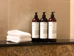 This undated image provided by Hyatt shows multi-use bottles. Hyatt Hotels Corp. is the latest hotel company to remove small bottles from its bathrooms in an effort to reduce waste. Hyatt says it is shifting to large, multi-use bottles for shampoo, conditioner, bath gel and lotion at its 875 hotels worldwide.  (Courtesy of Hyatt via AP)