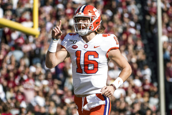 FILE - In this Nov. 30, 2019, file photo, Clemson quarterback Trevor Lawrence (16) celebrates a touchdown against South Carolina during the first half of an NCAA college football game in Columbia, S.C. Clemson is preseason No. 1 in The Associated Press Top 25, Monday, Aug. 24, 2020, a poll featuring nine Big Ten and Pac-12 teams that gives a glimpse at what's already been taken from an uncertain college football fall by the pandemic. (AP Photo/Sean Rayford, File)