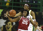 Oklahoma guard Madi Williams grabs a loose ball over Baylor forward NaLyssa Smith in the first half of an NCAA college basketball game, Saturday, Jan. 23, 2021, in Waco, Texas. (Rod Aydelotte/Waco Tribune-Herald via AP)