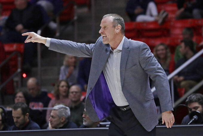 Utah coach Larry Krystkowiak shouts to his team during the first half of an NCAA college basketball game against UC Davis on Friday, Nov. 29, 2019, in Salt Lake City. (AP Photo/Rick Bowmer)