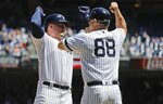New York Yankees' Luke Voit, left, celebrates with third base coach Phil Nevin as he runs the bases after hitting a three run home run during the fourth inning against the New York Mets in the first baseball game of a doubleheader, Tuesday, June 11, 2019, in New York. (AP Photo/Frank Franklin II)