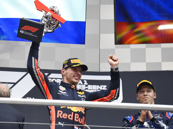 Red Bull driver Max Verstappen of the Netherland's celebrates on the podium after he won the German Formula One Grand Prix at the Hockenheimring racetrack in Hockenheim, Germany, Sunday, July 28, 2019. (AP Photo/Jens Meyer)