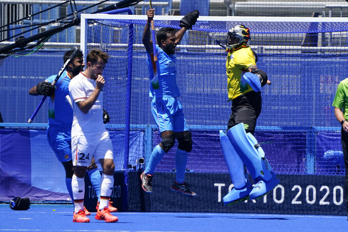 India goalkeeper Sreejesh Parattu Raveendran, center, celebrates after making a save as Germany's Benedikt Furk, second from left, looks on during the men's field hockey bronze medal match at the 2020 Summer Olympics, Thursday, Aug. 5, 2021, in Tokyo, Japan. (AP Photo/John Minchillo)