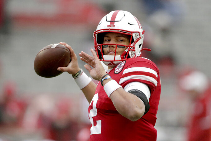 Nebraska quarterback Adrian Martinez warms up before an NCAA college football game against Iowa in Lincoln, Neb., Friday, Nov. 29, 2019. Martinez turned back a challenge from Luke McCaffrey to win the starting quarterback's job for Nebraska's opener at No. 5 Ohio State, coach Scott Frost announced Monday, Oct. 19, 2020. (AP Photo/Nati Harnik, File)