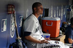 Seattle Mariners starting pitcher Chris Flexen sits in the dugout after he was pulled during the sixth inning of the team's  baseball game against the Oakland Athletics, Thursday, July 22, 2021, in Seattle. (AP Photo/Ted S. Warren)