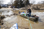 Andrew Bauer and Shawn Shonerd brings supplies to the Bellwood Lakes area Monday, March 18, 2019, in Bellwood, Neb. Much of the area was heavily impacted by flooding along the Platte River. (Brendan Sullivan/Omaha World-Herald via AP)