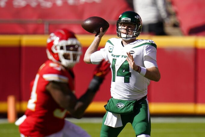 New York Jets quarterback Sam Darnold (14) throws a pass under pressure from the Kansas City Chiefs defense in the first half of an NFL football game on Sunday, Nov. 1, 2020, in Kansas City, Mo. (AP Photo/Jeff Roberson)