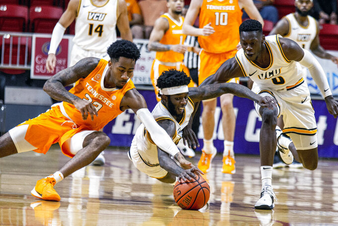 Tennessee guard Jordan Bowden (23), Virginia Commonwealth forward Issac Vann (23) and guard De'Riante Jenkins (0) battle for a loose ball in the first half ball game at the Emerald Coast Classic in Niceville, Fla., Saturday, Nov. 30, 2019. (AP Photo/Mark Wallheiser)