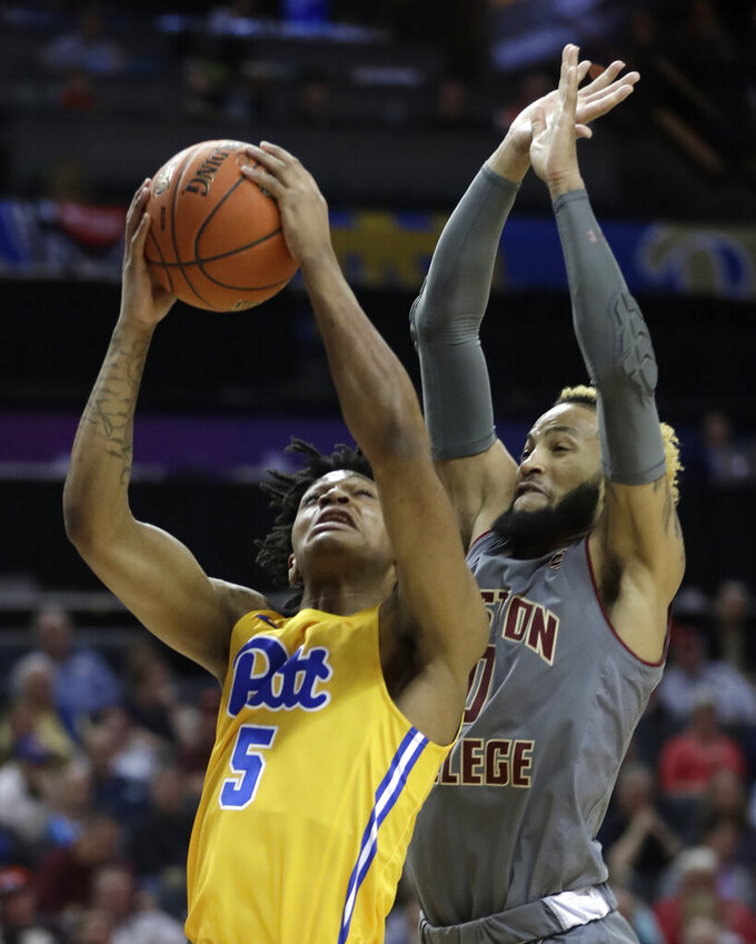Pittsburgh's Au'Diese Toney (5) shoots next to Boston College's Ky Bowman during the first half of an NCAA college basketball game in the Atlantic Coast Conference men's tournament in Charlotte, N.C., Tuesday, March 12, 2019. (AP Photo/Nell Redmond)
