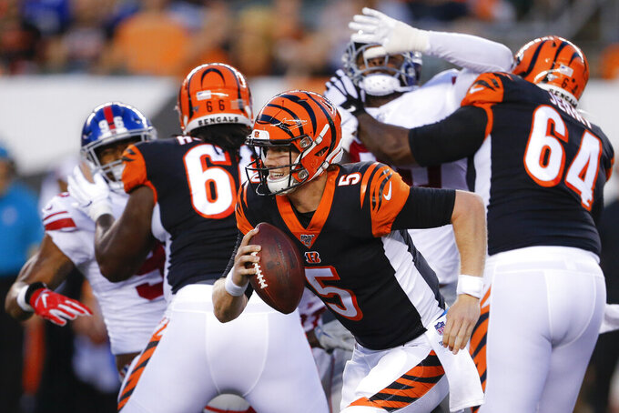 Cincinnati Bengals quarterback Ryan Finley (5) runs with the ball during the first half of the team's NFL preseason football game against the New York Giants, Thursday, Aug. 22, 2019, in Cincinnati. (AP Photo/Gary Landers)