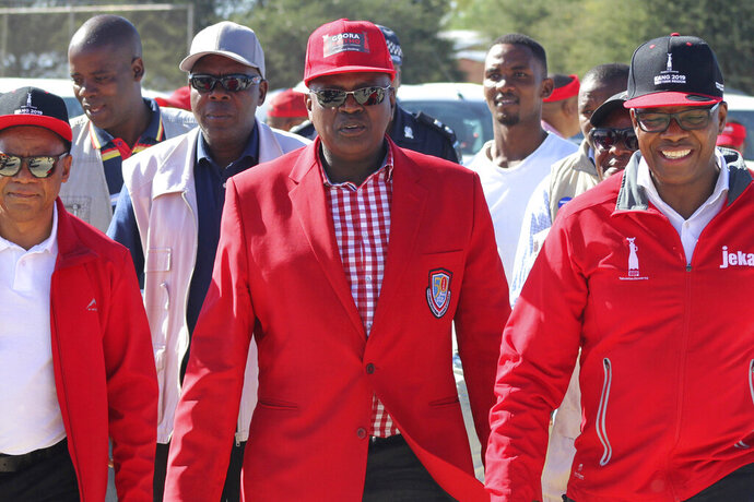 In this April 5, 2019, photo, Botswana's President Mokgweetsi Masisi, center, is photographed at a rally in Gaborone, Botswana. The country's ruling party, the BDF (Botswana Democratic Party) faces the tightest election of its history on Wednesday, Oct. 23, 2019 after former Botswana President Ian Khama, annoyed with his hand-picked successor, Masisi, announced his support for the opposition. (AP Photo/Sello Motseta)